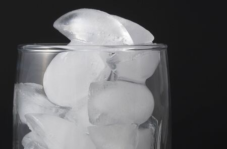 Ice cubes in a clear water glass. Stock fotó