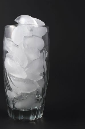 icecubes: Ice cubes in a clear water glass. Stock Photo