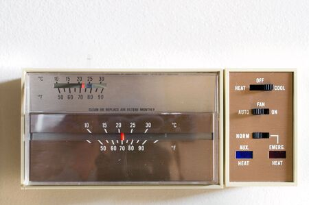 An indoor thermostat control for heating and air conditioning. Stock Photo - 1260478
