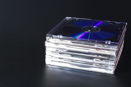 A stack of compact discs with recorded music.