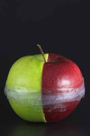 winesap apple: Red and green apple halves taped together.