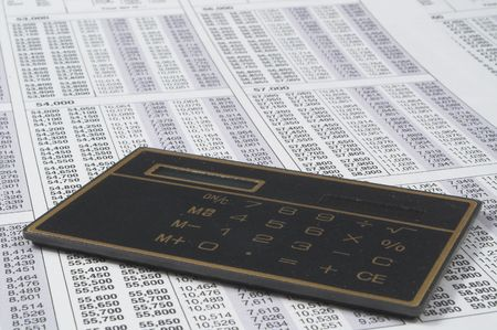 A calculator on top of tax forms. Stock Photo - 1319550