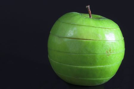 A sliced green apple in a stack. Stock Photo - 1335334