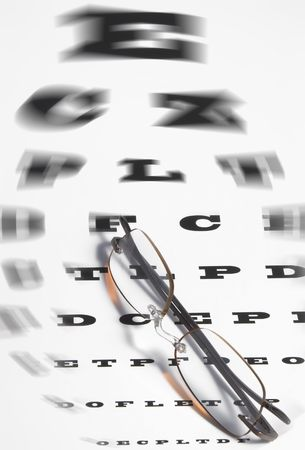 impair: Vision Care Concept - a pair of glasses and eye chart. Stock Photo