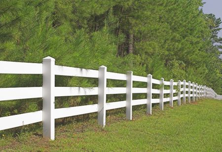 split rail: A decorative white split rail fence.