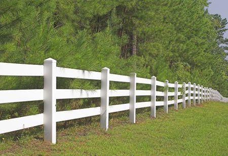 split rail: A decorative white split rail fence.