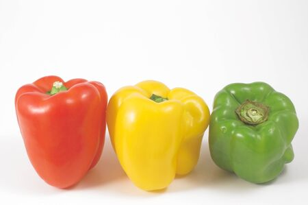 bell peppers: Several fresh and delicious stoplight bell peppers.