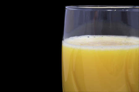 Fresh orange juice in a drinking glass. photo