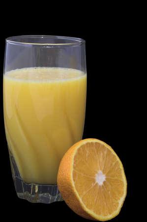 Zumo de naranja natural en un vaso. Foto de archivo - 1446407