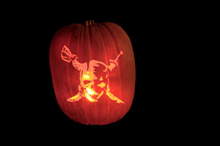 jackolantern: A lighted jack-o-lantern on a dark halloween night.