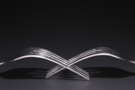 suppertime: Two silver forks.