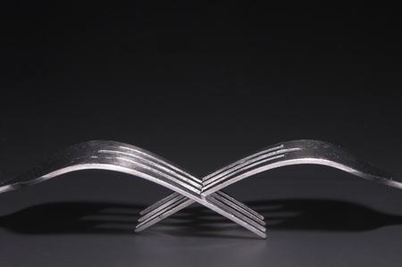 dinnertime: Two silver forks.
