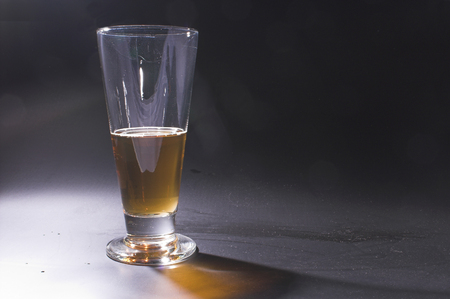 near beer: A glass of  beer on a bar. Stock Photo