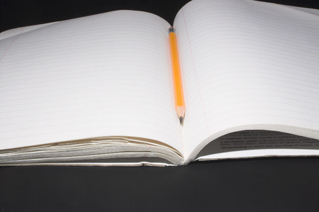 A composition book and a number 2 pencil. Stock Photo - 1479970