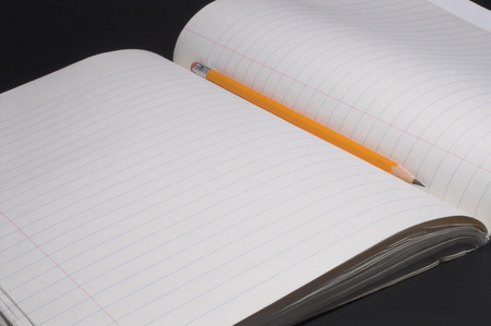 A composition book and a number 2 pencil. Stock Photo - 1479972
