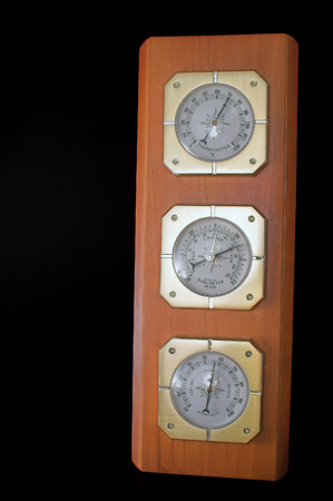 weather gauge: A weather station with a barometer, humidity gauge and thermometer. Stock Photo