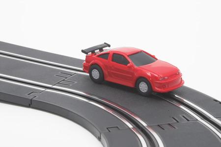 racecar: A slot car racing on a track.