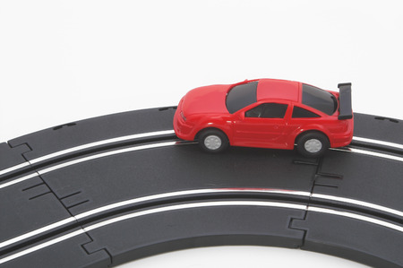 A slot car racing on a track. photo