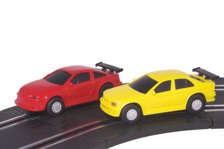 slot car track: Two slot cars racing on a track.