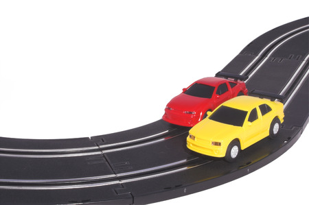 Two slot cars racing on a track. photo