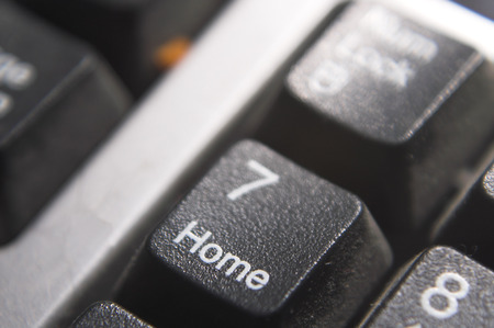 The home key on a computer keyboard. photo