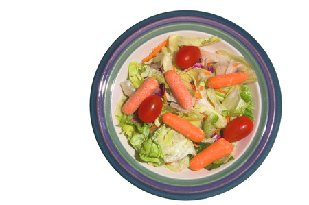 A garden salad with lettuce, carrots and tomatoes.