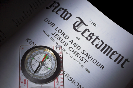 A compass pointing the way to the New Testament. photo