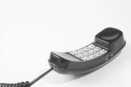 phone button: A corded telephone off of the hook. Stock Photo