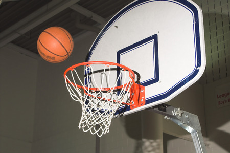 A basketball being shot into a goal. Stock Photo - 1683911