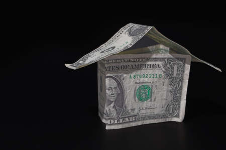 A house made out of one dollar bills - Realty  Investment Concept photo