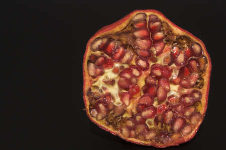 The cross section of a fresh pomegranate.