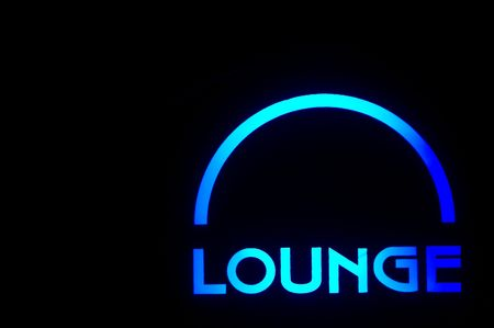 lounge: A neon lounge sign outside of a bar.