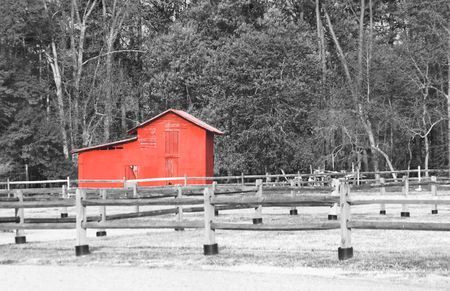 outbuilding: An old red barn on an abandoned farm.