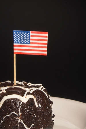 A piece of chocolate cake with the American flag. Stock Photo - 1849578