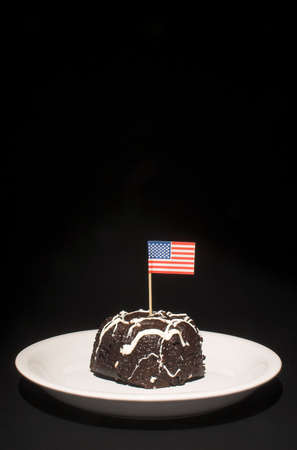 A piece of chocolate cake with the American flag. Stock Photo - 1849560
