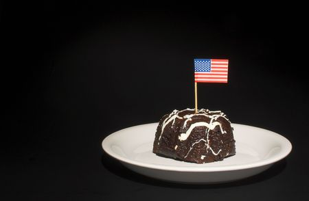 A piece of chocolate cake with the American flag. Stock Photo - 1849576