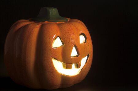 jackolantern: A lighted jack-o-lantern on a dark halloween night.