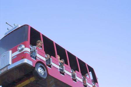 kiddie: A fire truck kiddie ride at a carnival.