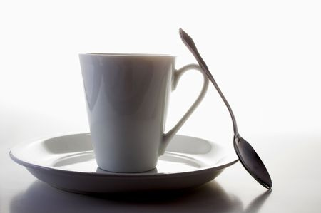 A coffee cup in the shadows of morning. Stock Photo - 1897190
