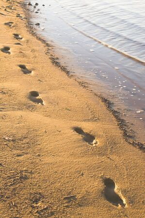 timeless: The traditional and timeless footprints in the sand.