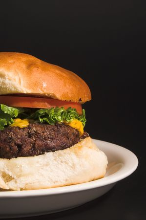 all american burger: A delicious cheeseburger with all the fixings.
