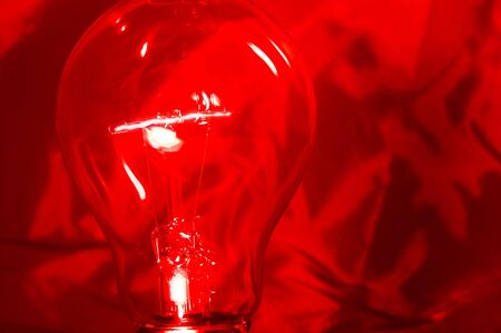 An incandescent light bulb with a burning filament. Stock Photo - 1976498