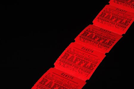 auction win: A strand of bright red rafflle tickets.