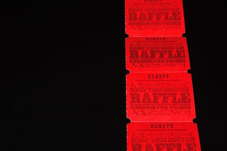 auction win: A strand of bright red raffle tickets.