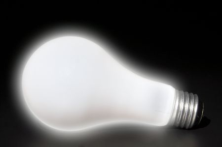 incandescent: A brightly lighted incandescent tungsten light bulb. Stock Photo