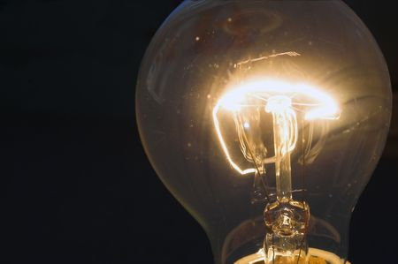 filament: An incandescent light bulb with a burning filament. Stock Photo