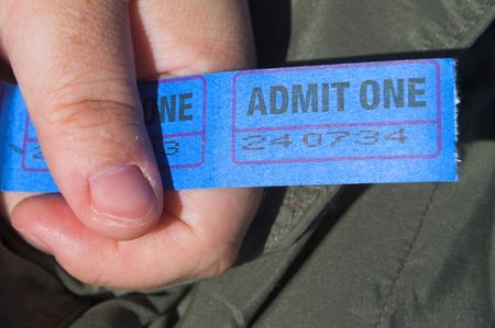carny: A person holding a string of admission tickets. Stock Photo