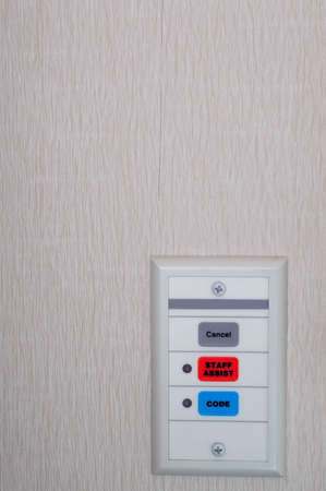 button: A set of hospital emergency code call buttons.