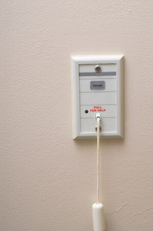 An emergency call pull switch in a hospital room. Stock Photo