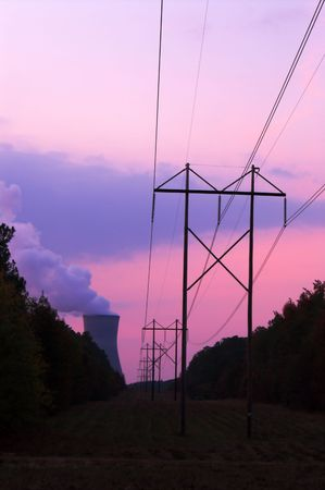 nuclear power plant: A functioning nuclear power plant at sunset.